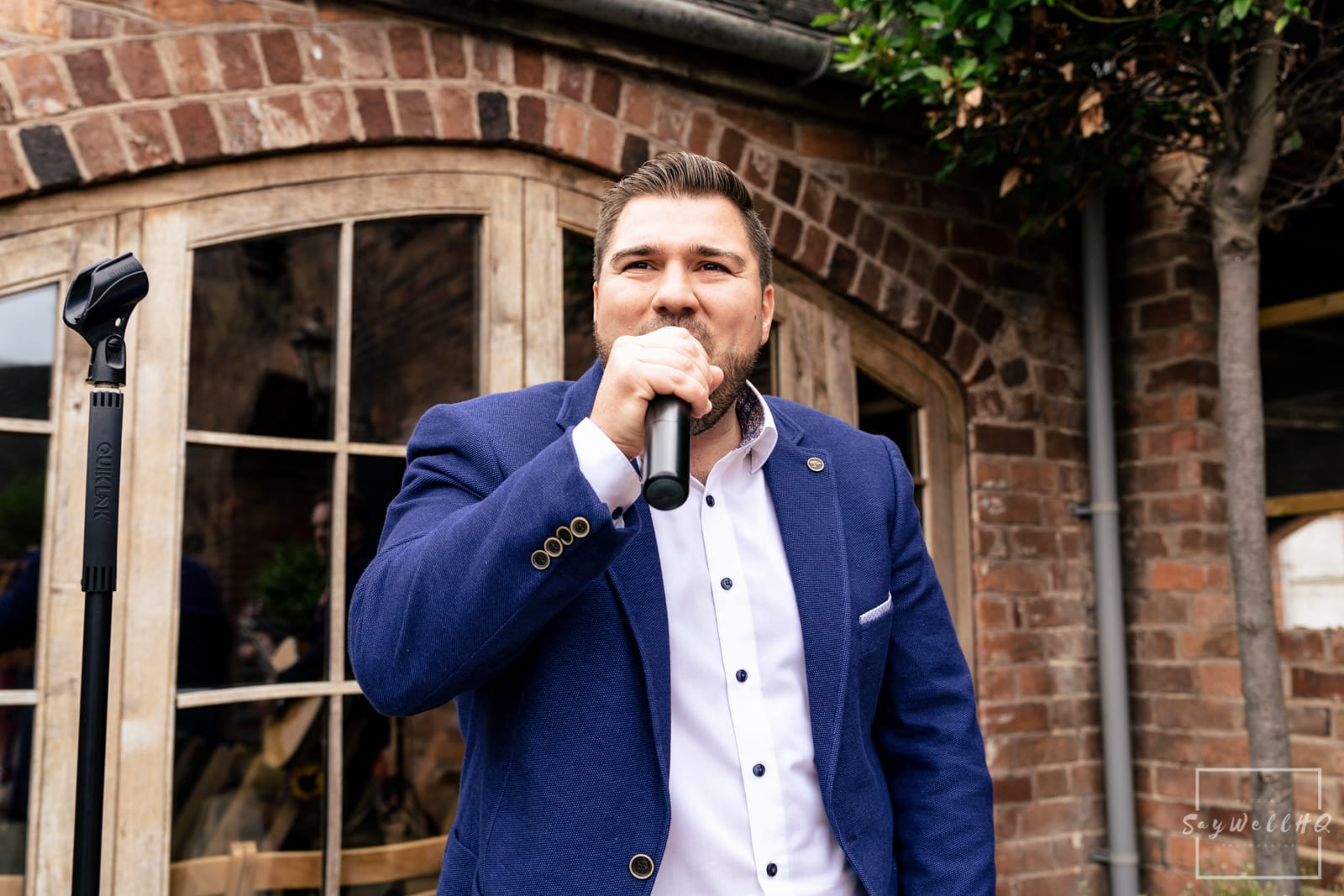 Mapperley Farm Wedding Photography + Mapperley Farm Wedding Photographer + live music is played as wedding guests celebrate in the courtyard after the wedding ceremony in a converted barn