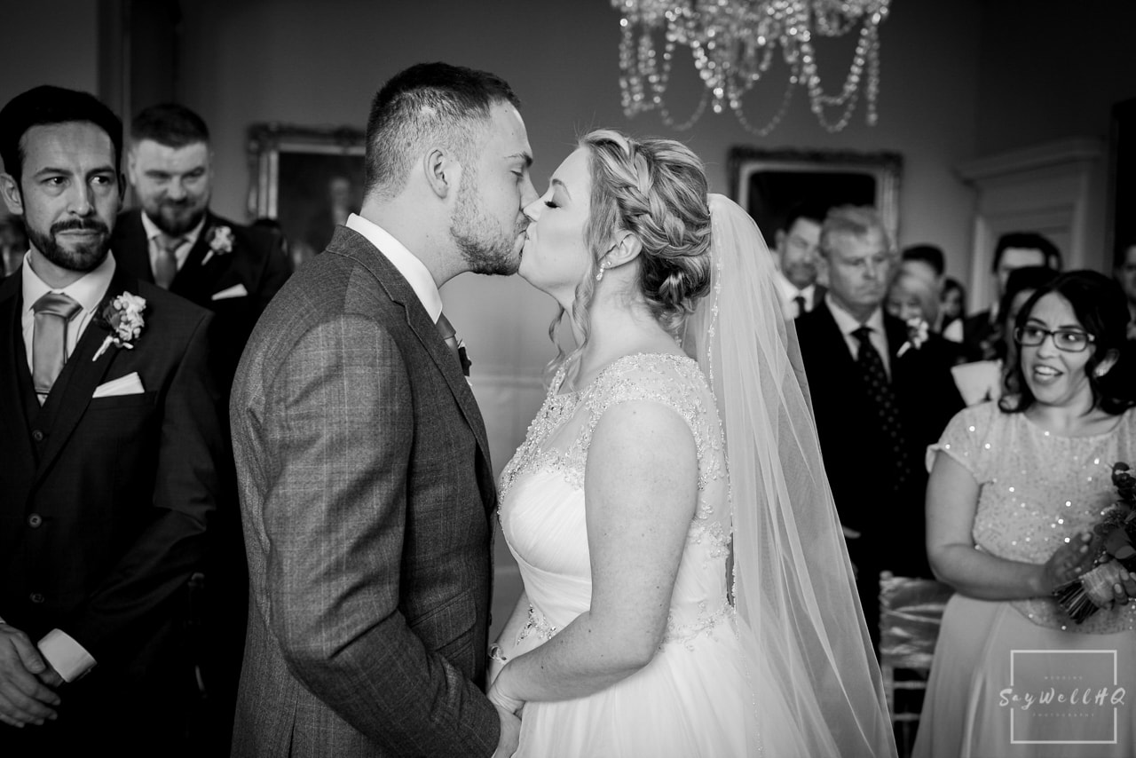 Norwood Park Wedding Photography + bride and groom first kiss during their Norwood Park Wedding Ceremony
