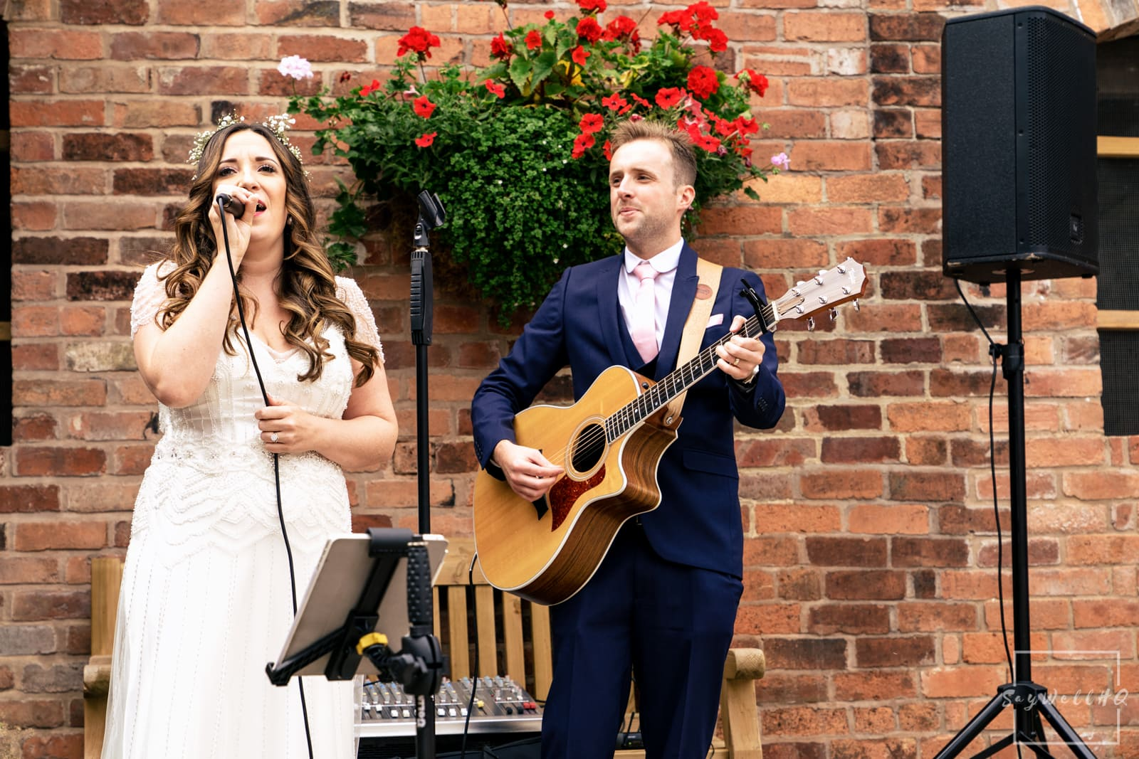 Mapperley Farm Wedding Photography + Mapperley Farm Wedding Photographer + Bride sings as wedding guests celebrate in the courtyard after the wedding ceremony in a converted barn