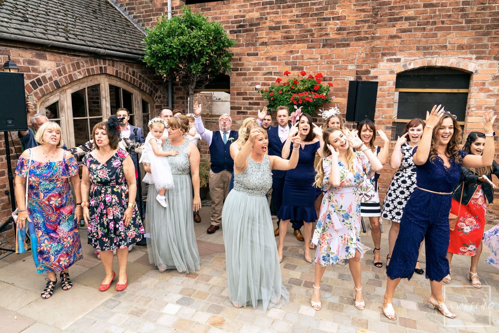Mapperley Farm Wedding Photography + Mapperley Farm Wedding Photographer + Bride is surprised by a flashmob dance and singalong after her wedding ceremony