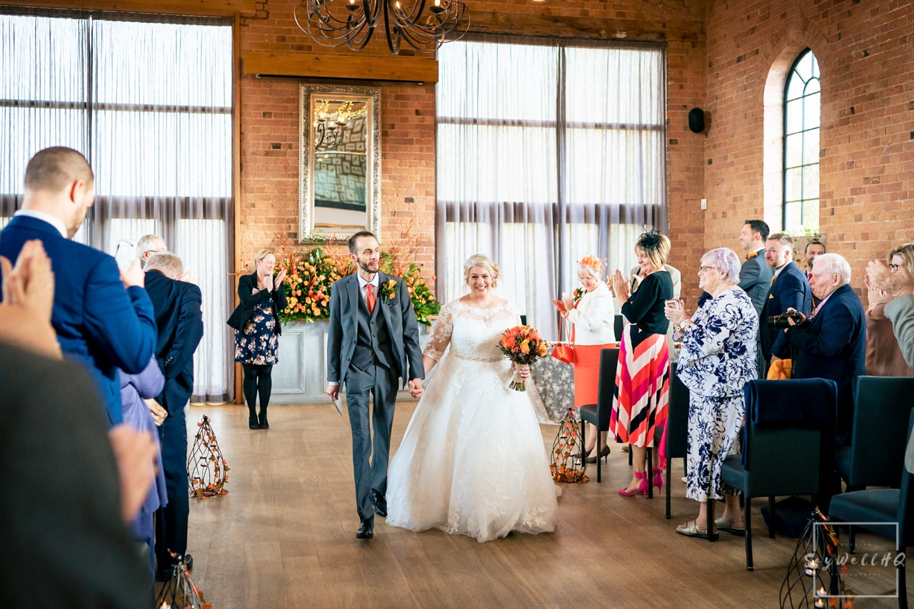 The Carriage Hall Wedding Photography + Carriage Hall Wedding Photographer + Bride and groom walking back down the aisle after the wedding ceremony