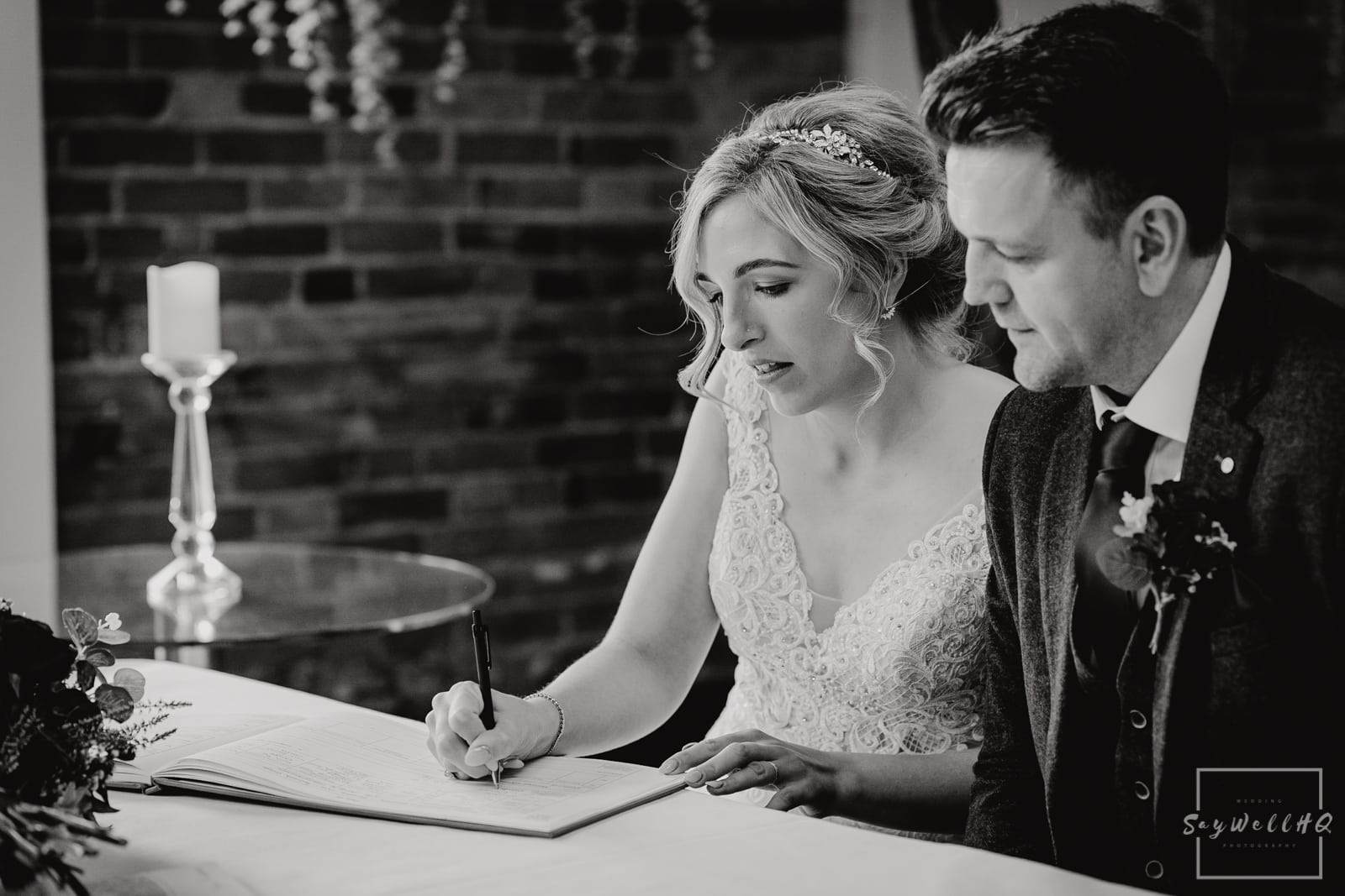 Goosedale Wedding Photography + Goosedale Wedding Photographer + Bride signs the wedding register at a wedding at Goosedale in Nottingham