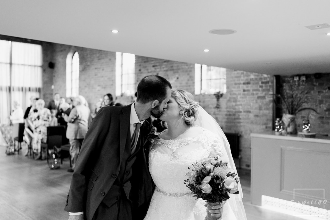 The Carriage Hall Wedding Photography + Carriage Hall Wedding Photographer + Bride and groom kiss after their wedding ceremony