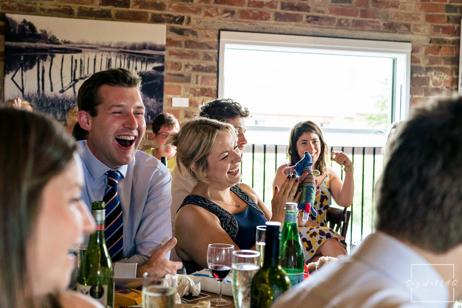 Leicester Wedding Photography + Leicester Wedding Photographer + Humanist Wedding Photographer + wedding guests react to the groom and the best man doing their wedding speeches