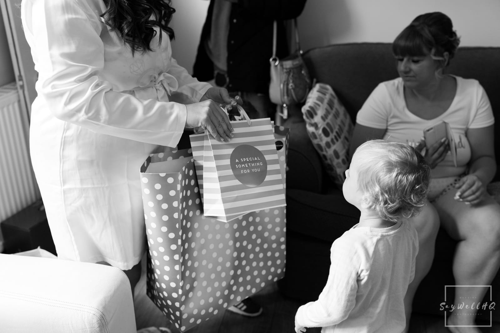 Mapperley Farm Wedding Photography + Mapperley Farm Wedding Photographer + Bride hands out wedding gifts to her pageboys and flowergirls