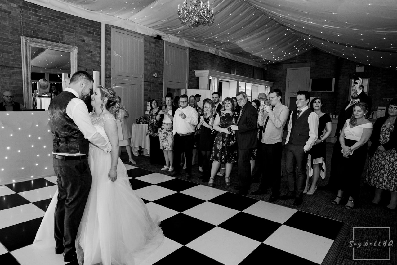 Norwood Park Wedding Photography + Bride and groom dance during the wedding first daqnce at Norwood Park