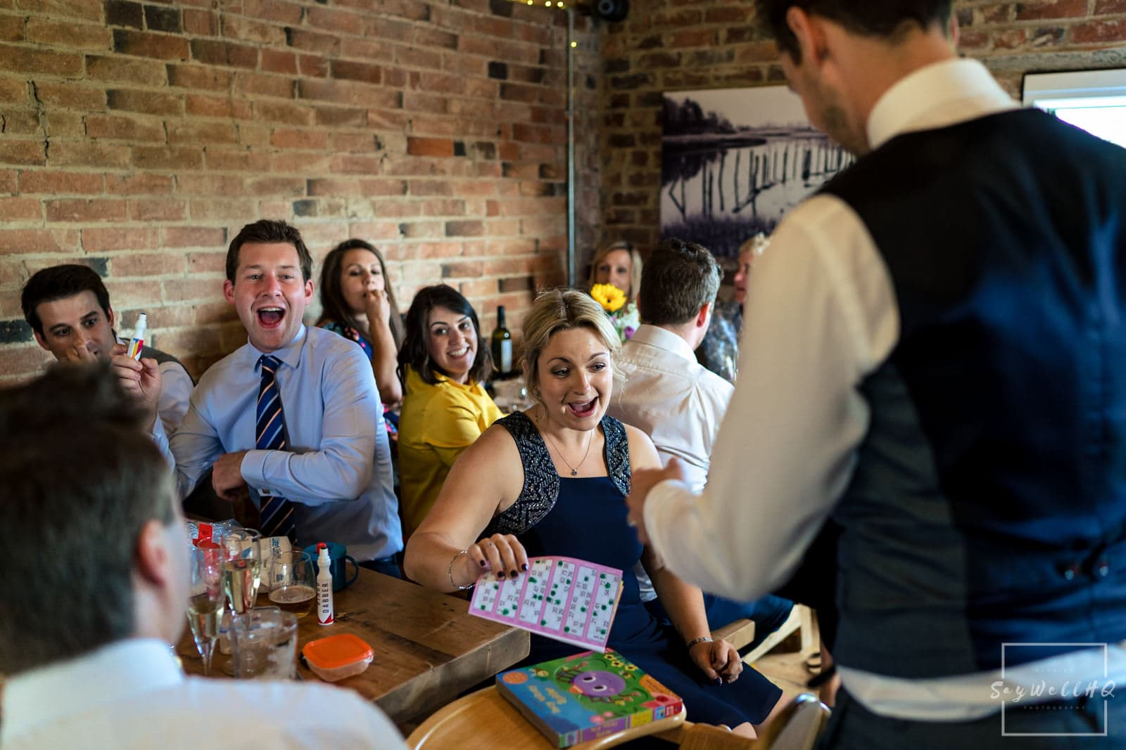 Leicester Wedding Photography + Leicester Wedding Photographer + Humanist Wedding Photographer + wedding guests playing bingo with the Bride and groom calling out the numbers
