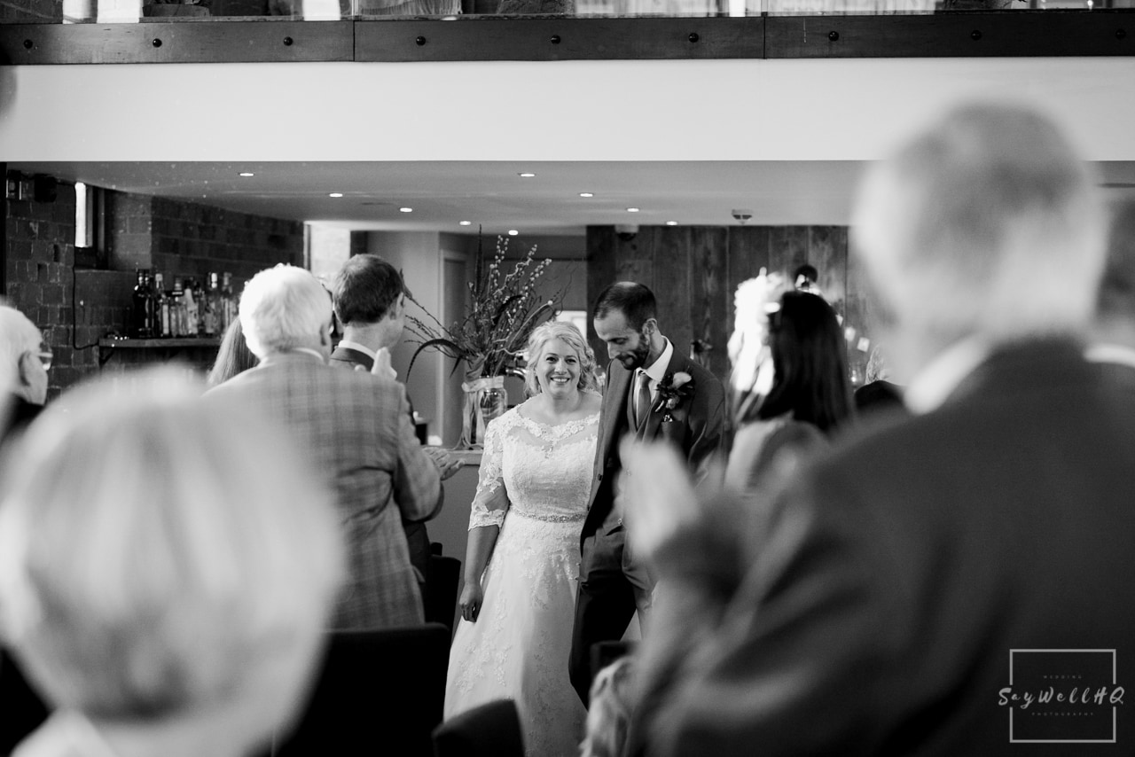 The Carriage Hall Wedding Photography + Carriage Hall Wedding Photographer + Bride and groom enter for the wedding breakfast as husband and wife