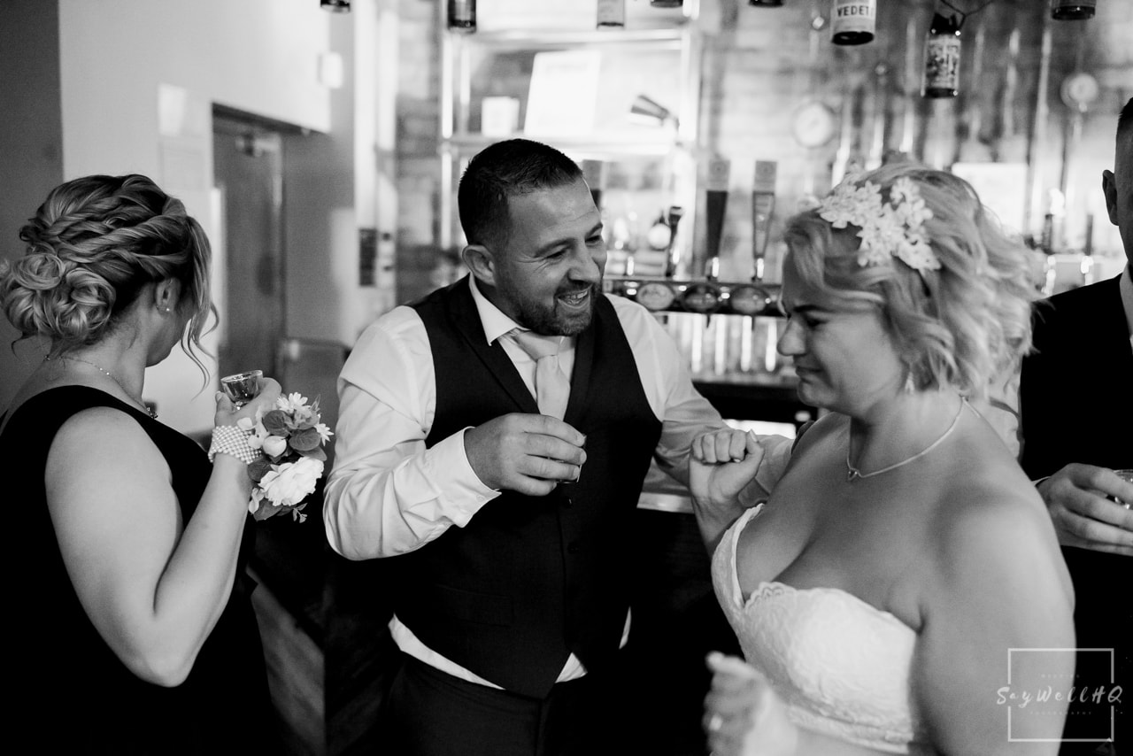 Brewhouse and Kitchen Wedding Photography + The Riverside Gallery Wedding Photographer + bride and groom celebrate with a strong shot of whiskey