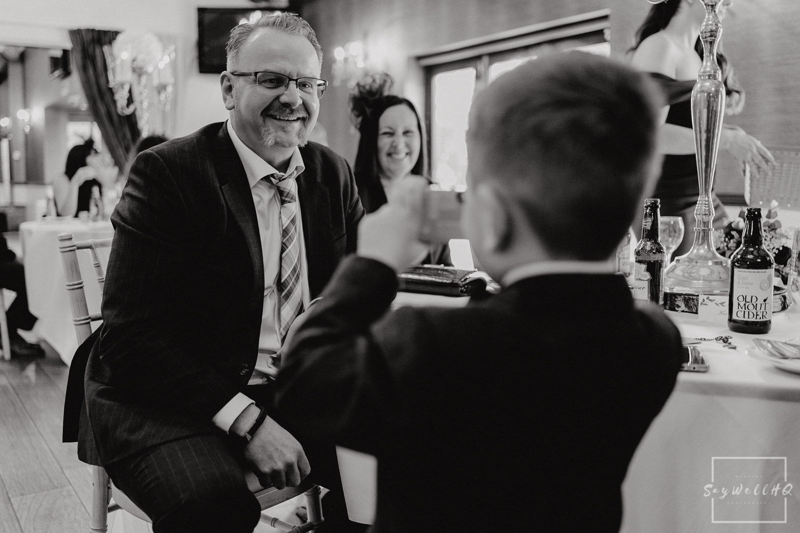 Goosedale Wedding Photography + Goosedale Wedding Photographer + wedding guests chat and enjoy the wedding breakfast at a Goosedale wedding in Nottingham