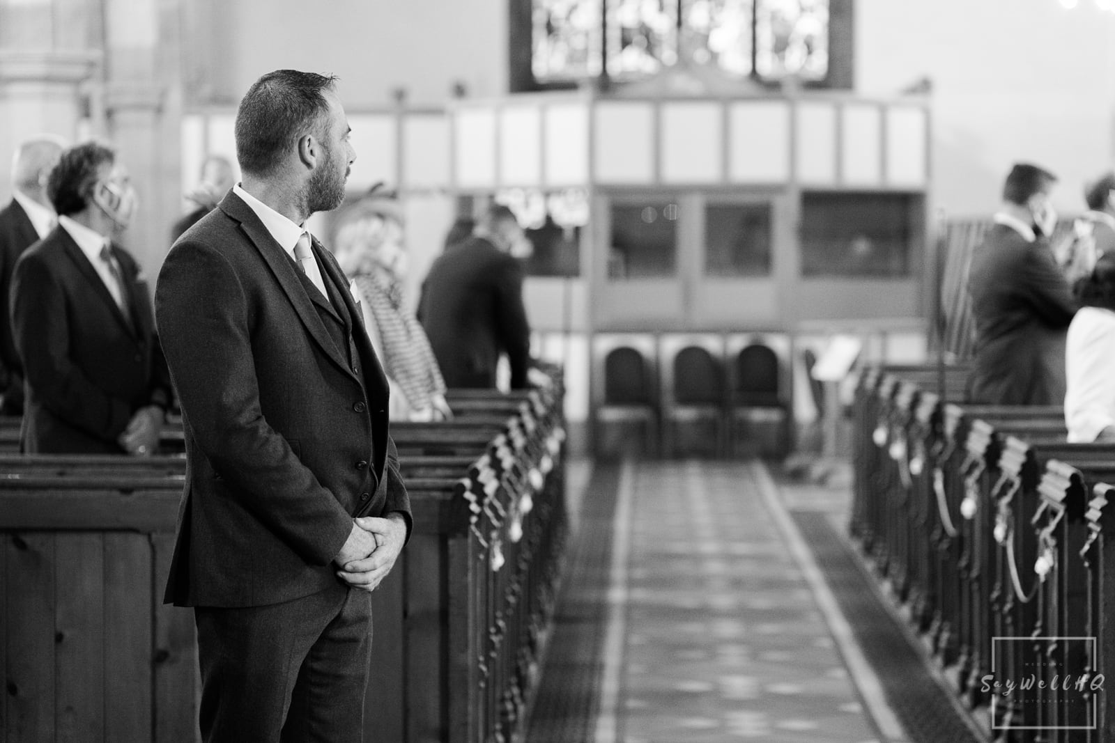 Lincoln Wedding Photography + Spilsby Church Wedding Photographer + groom waiting patiently for his bride to walk down the aisle