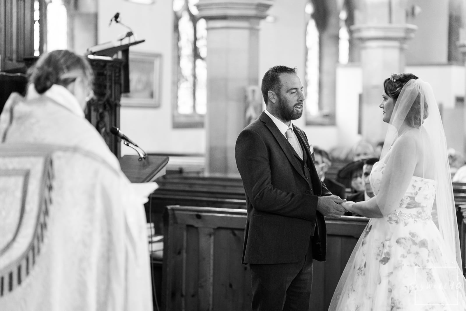 Lincoln Wedding Photography + Spilsby Church Wedding Photographer + Bride and groom exchange wedding rings during their Lincoln Church Wedding