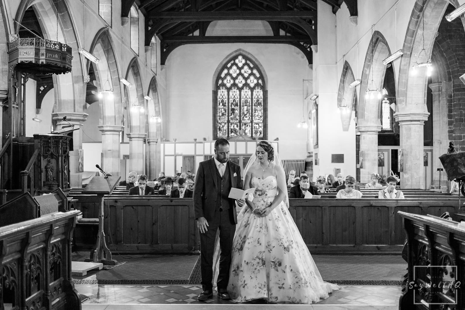 Lincoln Wedding Photography + Spilsby Church Wedding Photographer + Bride and groom sing during their wedding ceremony