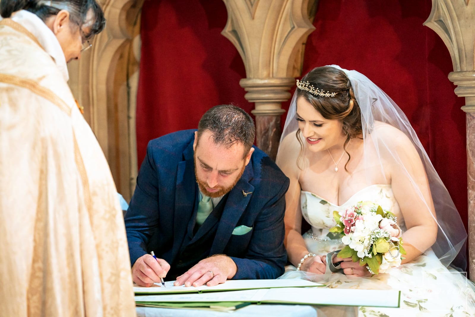 Lincoln Wedding Photography + Spilsby Church Wedding Photographer + Bride and groom sign the wedding register