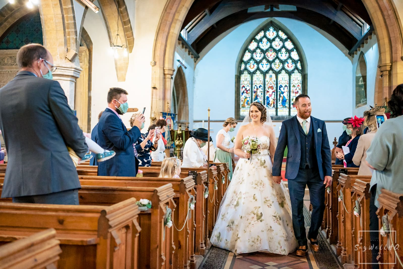 Lincoln wedding photographer - bride and groom walking down the aisle as husband and wife
