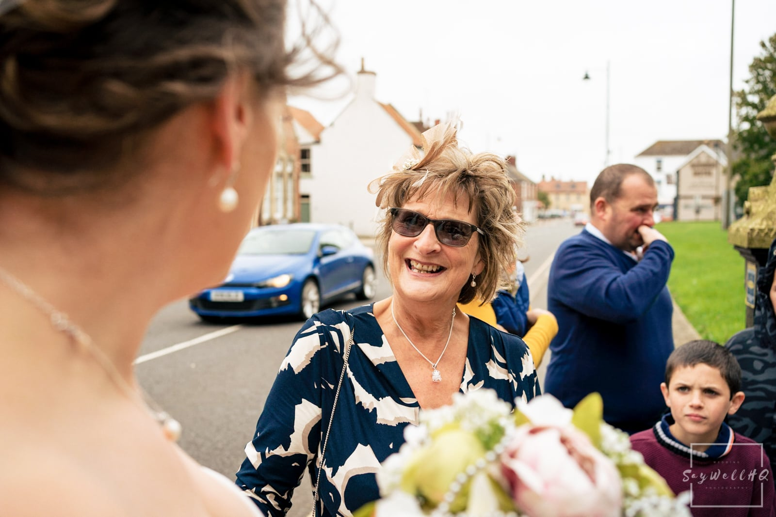 Lincoln Wedding Photography + Spilsby Church Wedding Photographer + Bride and groom celebrate with their wedding guests after their wedding ceremony in Lincoln
