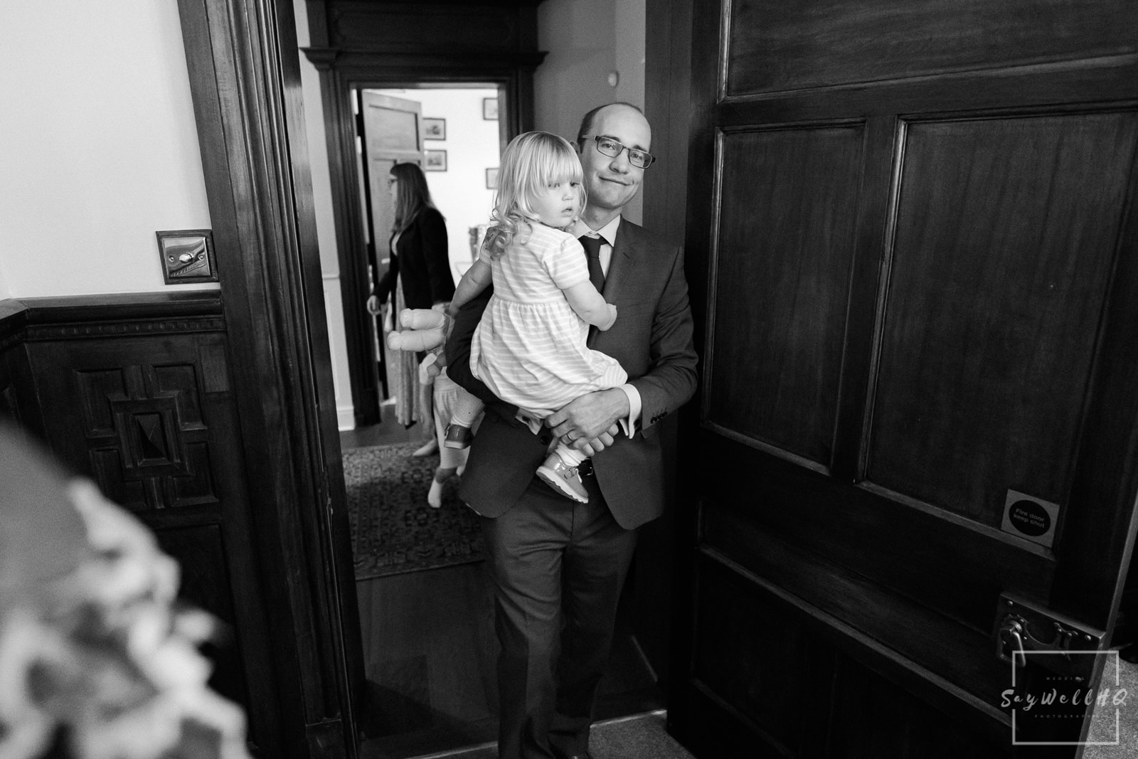 Lincoln Wedding Photography + Spilsby Church Wedding Photographer + wedding guests find their seats for the wedding reception at Skendleby Hall