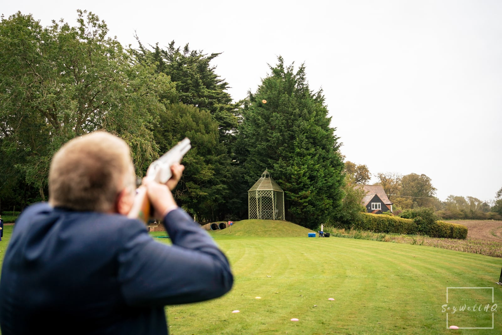 Lincoln Wedding Photography + Spilsby Church Wedding Photographer + Groom and his friends enjoy clay pigeon shooting at Skendleby Hall